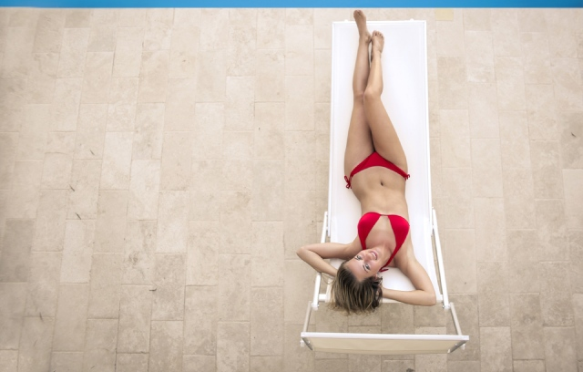 slim-woman-in-bikini-lying-on-deckchair-3771817-2.jpg
